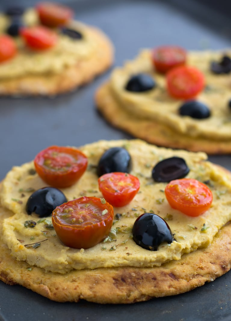 Black olives, cherry tomatoes and hummus pizza