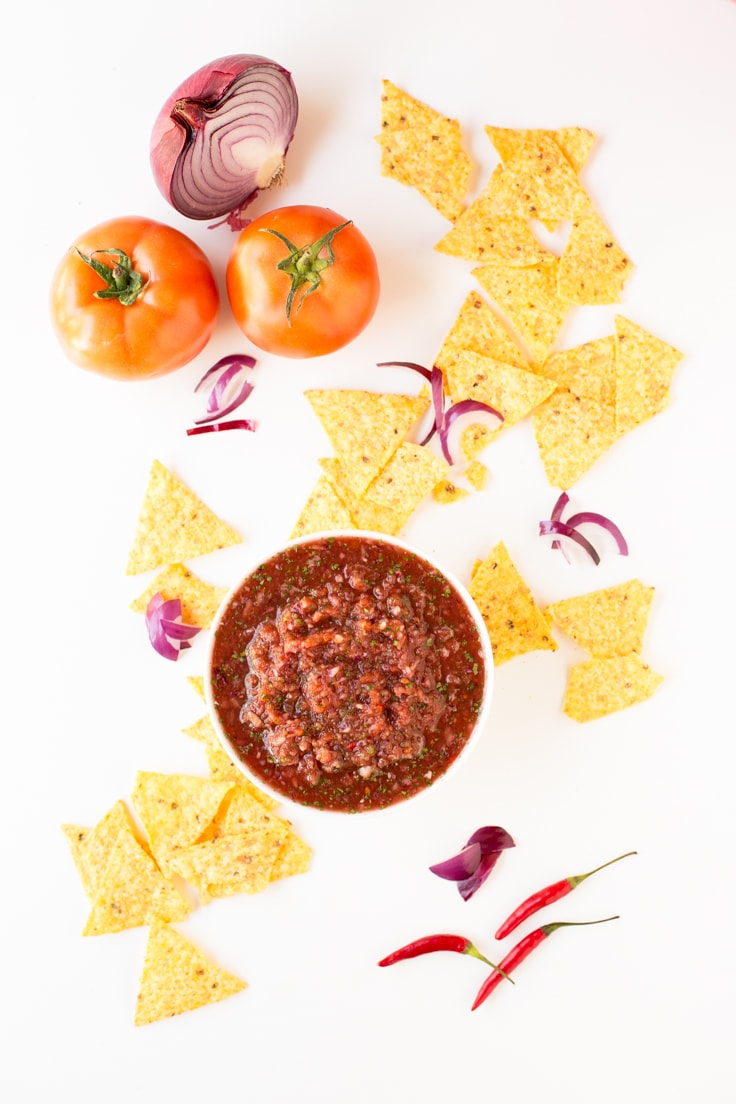 Salsa With Tortilla Chips - You're going to love this salsa, is so tasty, spicy and you just have to blend all the ingredients in a food processor.