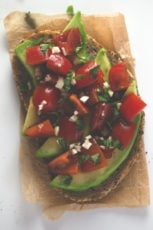 Avocado tomato bruschetta - If you love savory things, you're going to love this avocado, tomato bruschetta because it tastes great and is ready in less than 10 minutes.