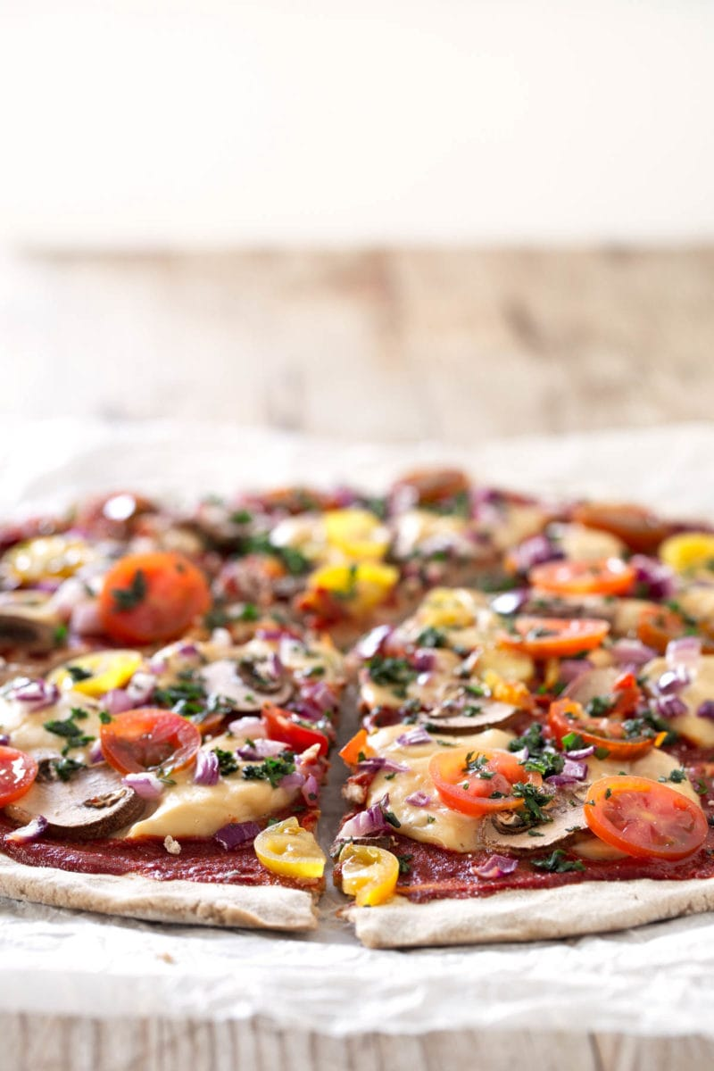 Simple Vegan Gluten Free Pizza.- This delicious pizza is homemade, vegan, gluten-free, low in fat and so easy to make. Feel free to add your favorite veggies and ingredients.