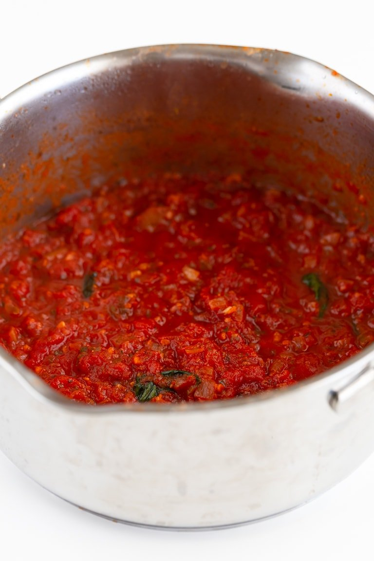 Photo of a pot with marinara sauce in it