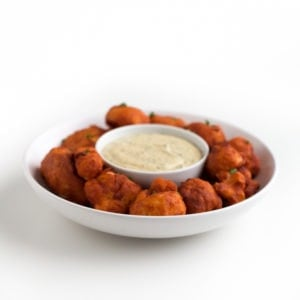 Square photo of a bowl of buffalo cauliflower wings