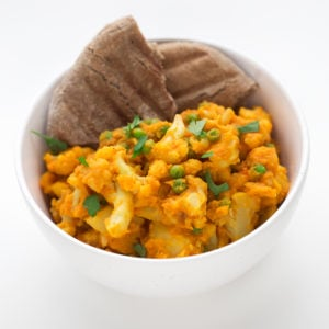Aloo Gobi Matar - Aloo gobi matar is an Indian curry made with potato, cauliflower and peas. It's ready in 20 minutes and our recipe is low in fat.
