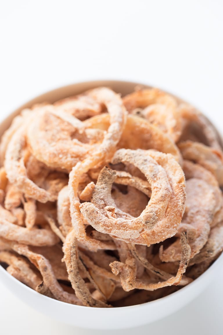 Baked Onion Strings (Vegan + Gluten Free) - Easy homemade, vegan, gluten-free baked onion rings. Enjoy them as a snack, appetizer, on your burgers, salads or on top of green bean casseroles.