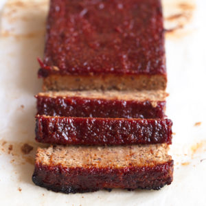 A square picture of a sliced vegan meatloaf