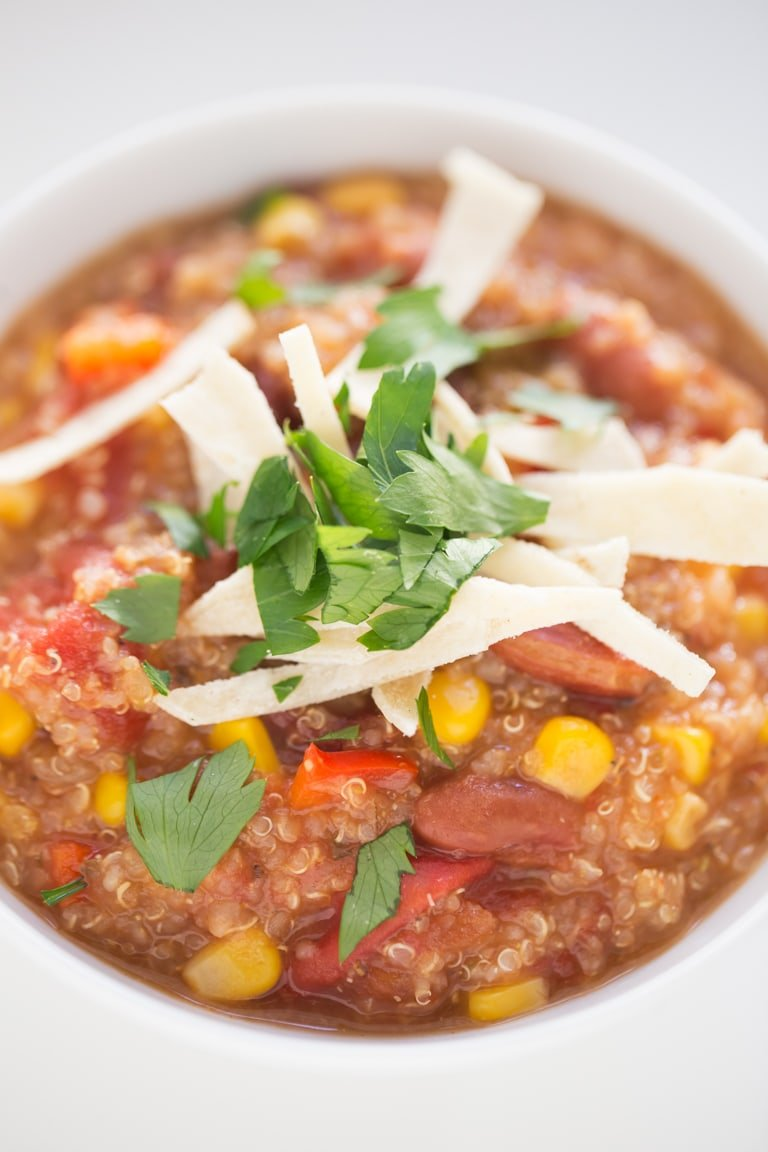Slow Cooker Vegan Quinoa Chili - Super healthy vegan quinoa chili, made right in the Crock-pot. It's so thick, filling, flavorful and the perfect bowl of comfort food!