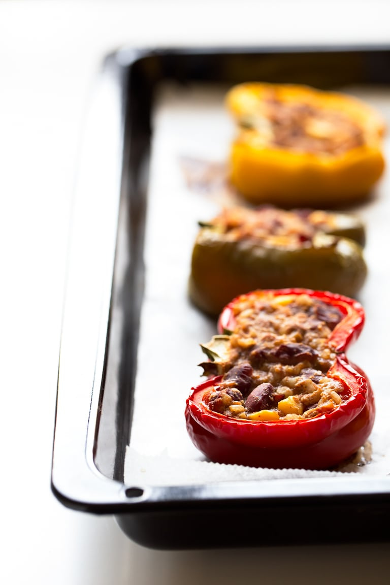 Vegan Stuffed Peppers - Simple, tasty, vegan stuffed peppers made with just 9 ingredients. They're also gluten-free, super healthy and a great entree or side dish.