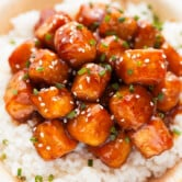 Photo of a bowl of general tso's tofu served over some rice