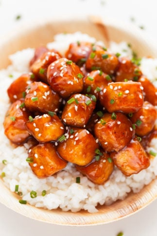 Tofu Cubes Topped with Spicy Sauce & Sesame Seeds on White Rice