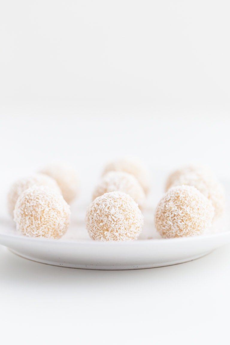 No Bake Coconut Snowballs (3 Ingredients!) - No bake coconut snowballs. They're the perfect dessert or snack for athletes, students and people who want something sweet made with 3 natural ingredients.