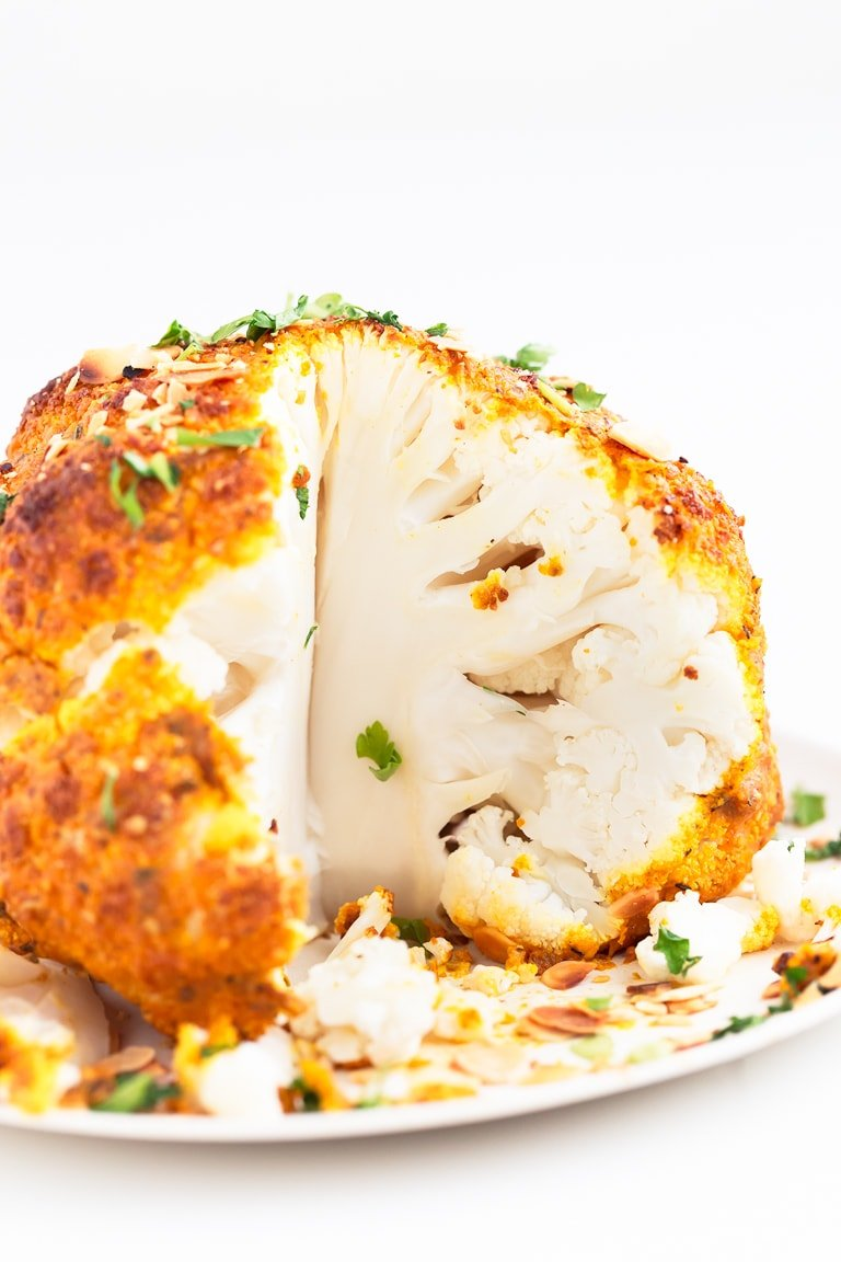 Whole Roasted Cauliflower - Whole roasted cauliflower, a great vegan alternative for the holidays, special occasions or everyday cooking. It's a delicious side or main dish. #vegan #glutenfree #simpleveganblog