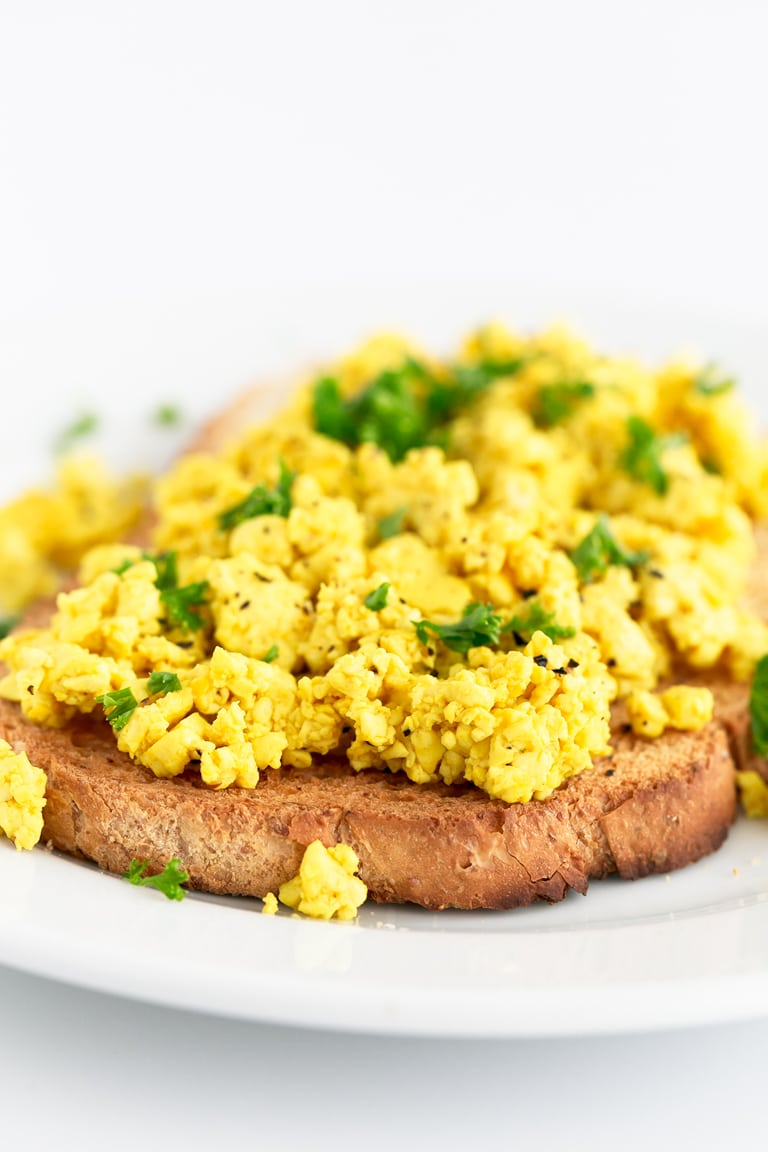 A Side Shot of Tofu Scramble topped with Chopped Chives On Bread
