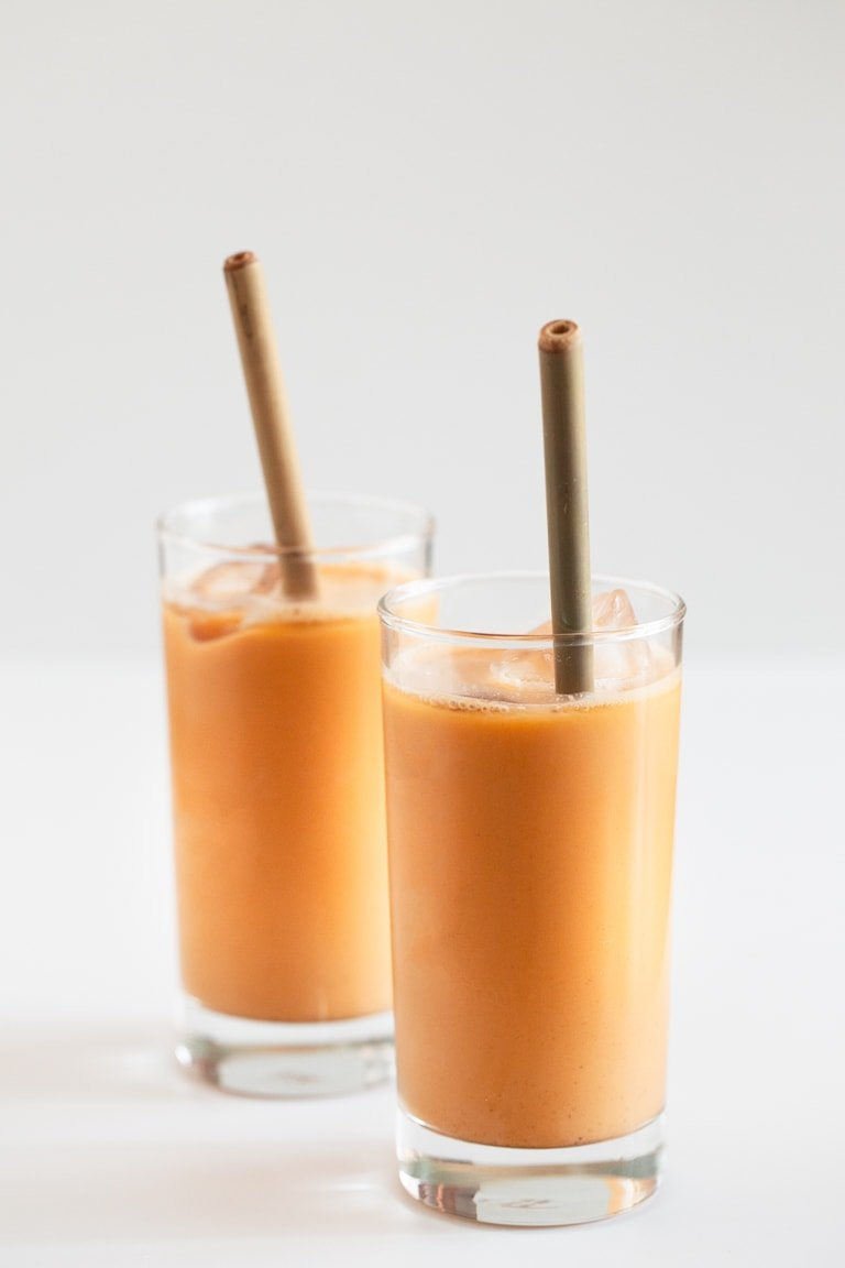 Vegan Thai Iced Tea - Thai iced tea is a delicious, creamy and refreshing beverage. We've made a vegan version using coconut milk. It's healthier and only requires 5 ingredients! #vegan #glutenfree #simpleveganblog