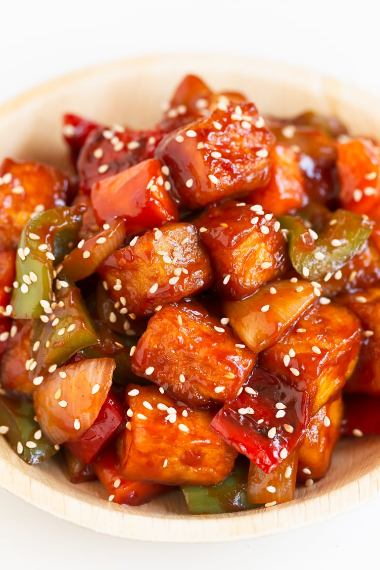 Close-up shot of a bowl of sweet and sour tofu