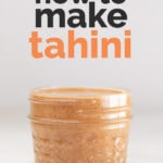 "A picture of a glass container with homemade tahini and the words ""How to make tahini"""