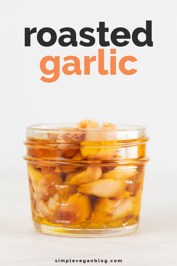 A side shot of a jar with roasted garlic cloves and covered with oil for Pinterest