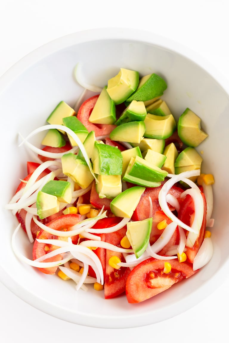 Tomato Avocado Salad (Oil-Free). - A simple tomato avocado salad, made in less than 10 minutes with just 4 ingredients and our oil-free tahini salad dressing. #vegan #glutenfree #simpleveganblog