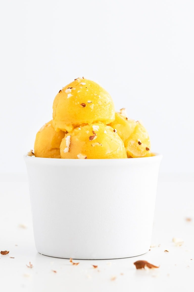 How To Make Sorbet. - Learn how to make sorbet at home with any fruit. It only requires 4 ingredients: fresh fruit, water, dates (or any sweetener) and lemon juice. #vegan #glutenfree #simpleveganblog