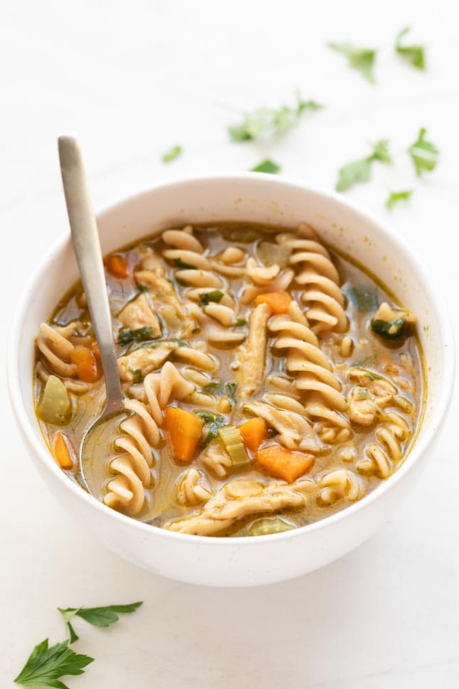 Photo of a bowl of vegan chicken noodle soup