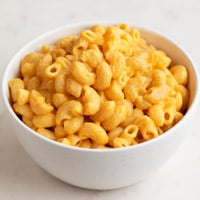 A square picture of a bowl of vegan mac and cheese