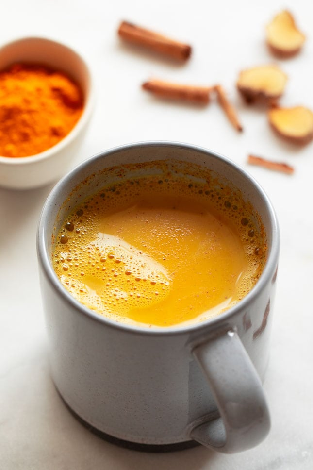 Photo of a mug with golden milk on the inside