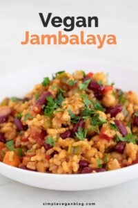 A picture of a dish of vegan jambalaya with the words vegan jambalaya