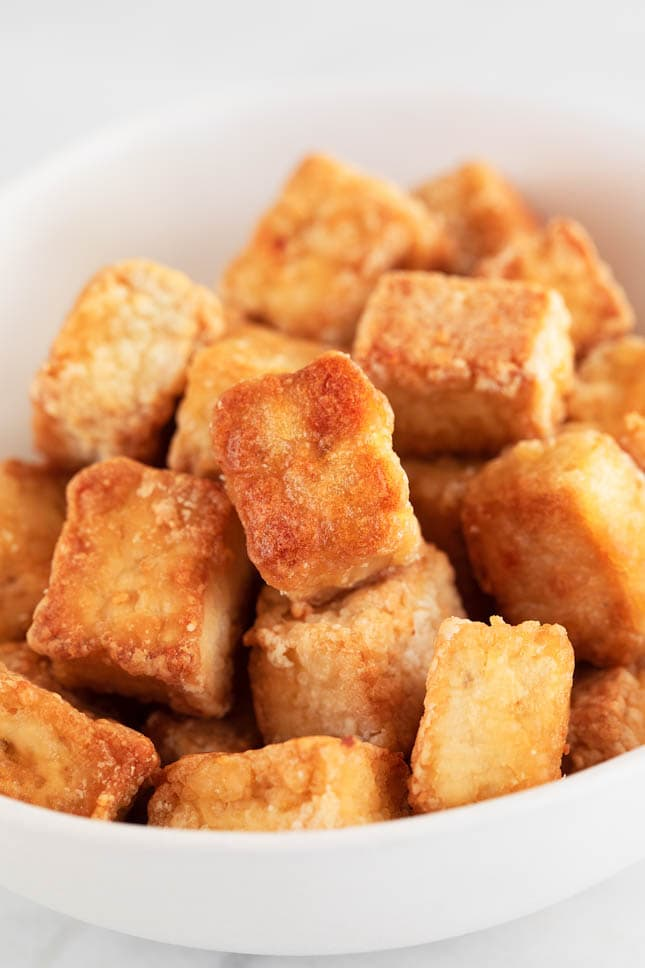 Close-up shot of a bowl of baked tofu