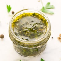 Square photo of chimichurri sauce in a little glass