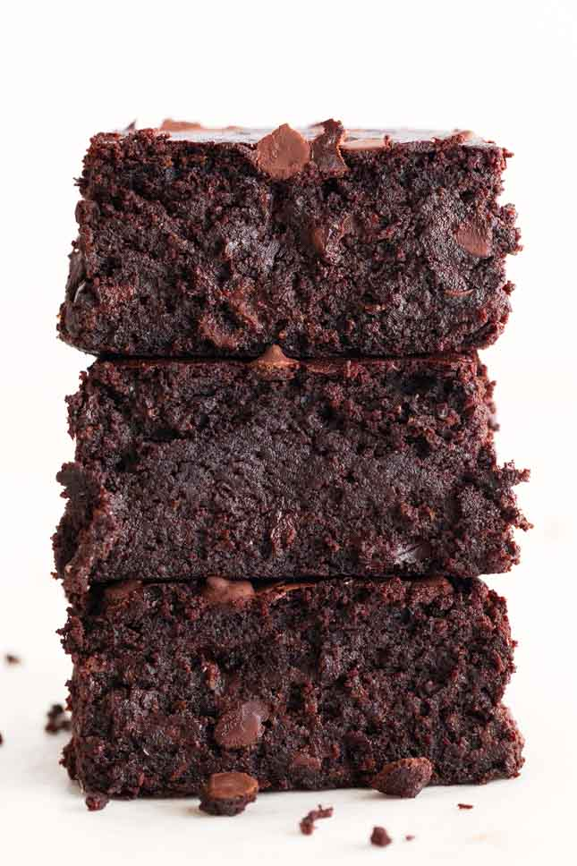 A side shot of 3 vegan brownies made from scratch