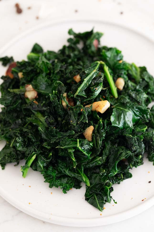 Close-up shot of a plate of sauteed kale
