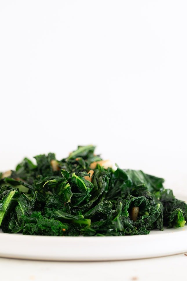 Side shot of a plate of sauteed kale