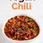 A picture of a bowl with homemade vegan chili with the words vegan chili