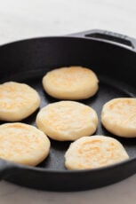 Close-up picture of 6 arepas on a pan