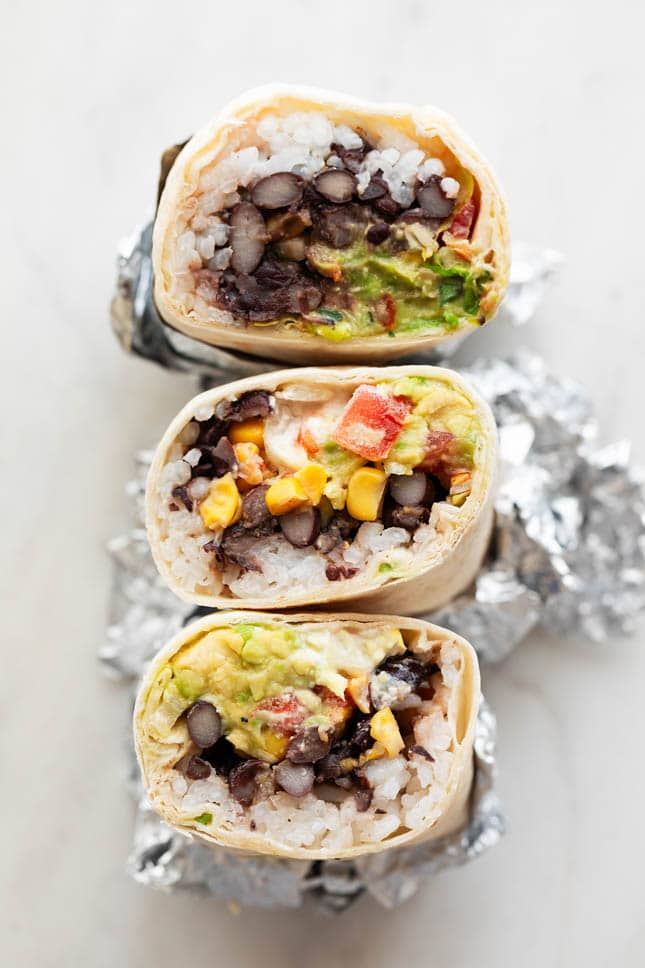 Photo of 3 vegan burritos cut in half