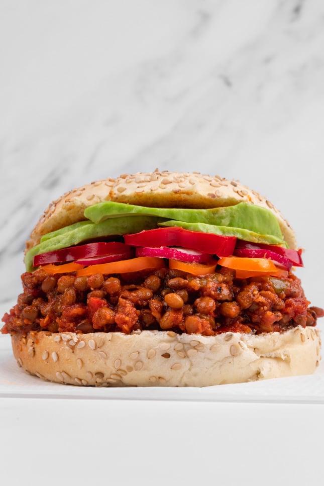 Side shot of a sandwich made of vegan sloppy joes