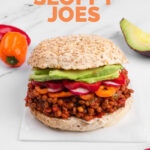 Photo of a sandwich of vegan sloppy joes with the words vegan sloppy joes