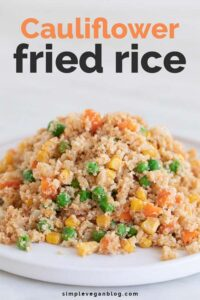 A shot of a white dish with some cauliflower fried rice with the words cauliflower fried rice