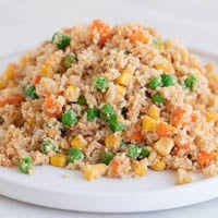 A small picture of a white dish with some cauliflower fried rice