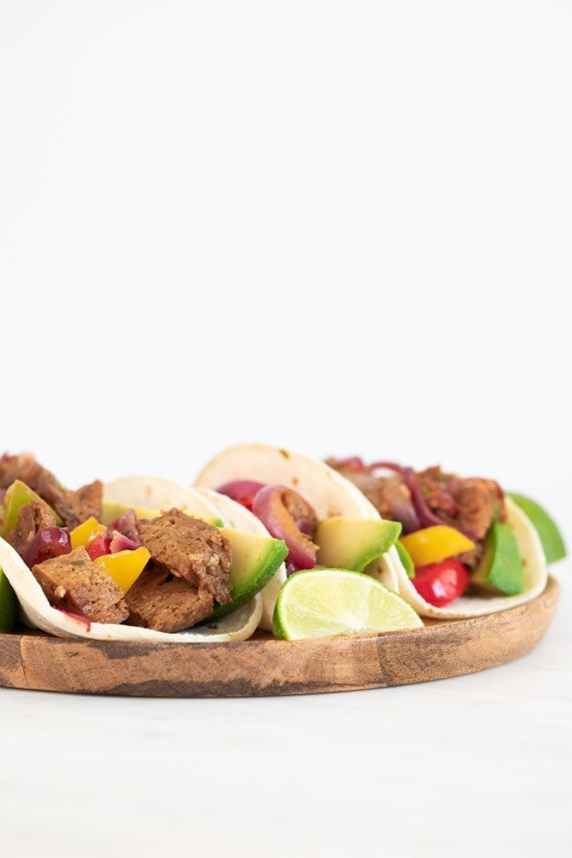 A frontal shot of a dish with vegan fajitas