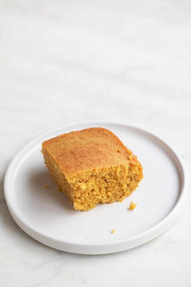 A picture of a small white dish with some vegan cornbread made from scratch