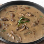 Photo of a bowl of mushroom gravy with the words mushroom gravy