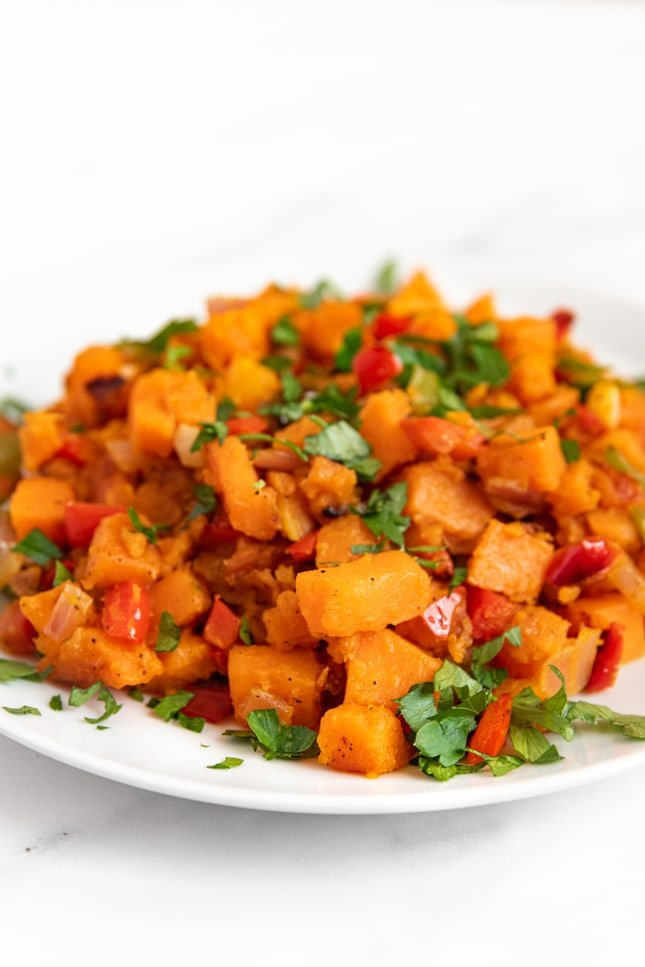 Side shot of a plate of sweet potato hash