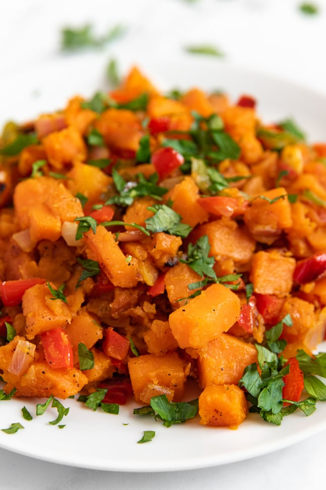 Close-up shot of a plate of sweet potato hash
