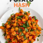 Photo of a plate of sweet potato hash with the words sweet potato hash