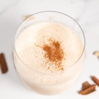 Square photo of a glass of vegan eggnog