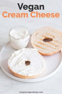 A picture of a dish with a bowl with vegan cream cheese and a sliced bagel