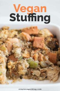 A close shot of a baking dish with vegan stuffing with the words vegan stuffing