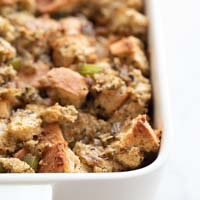 A square picture of a baking dish with cegan stuffing made from scratch