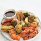 Photo of a plate of vegetable tempura and a small bowl with soy sauce