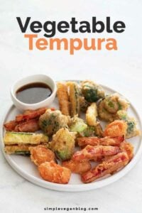 A photo of a dish with homemade vegetable tempura and a small bowl with soy sauce
